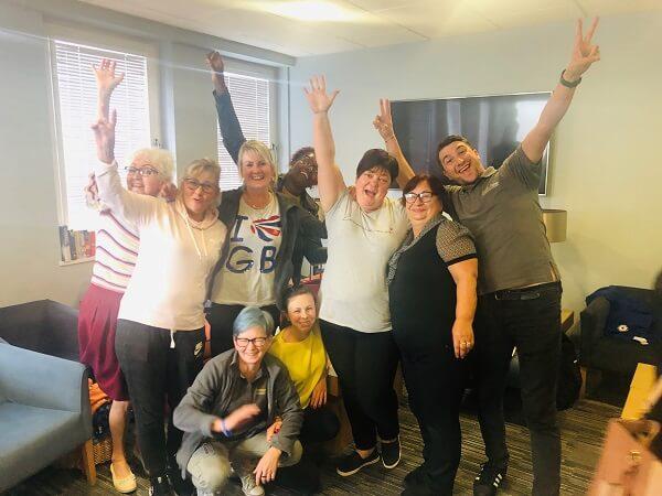 House of Fisher team celebrating passing exam